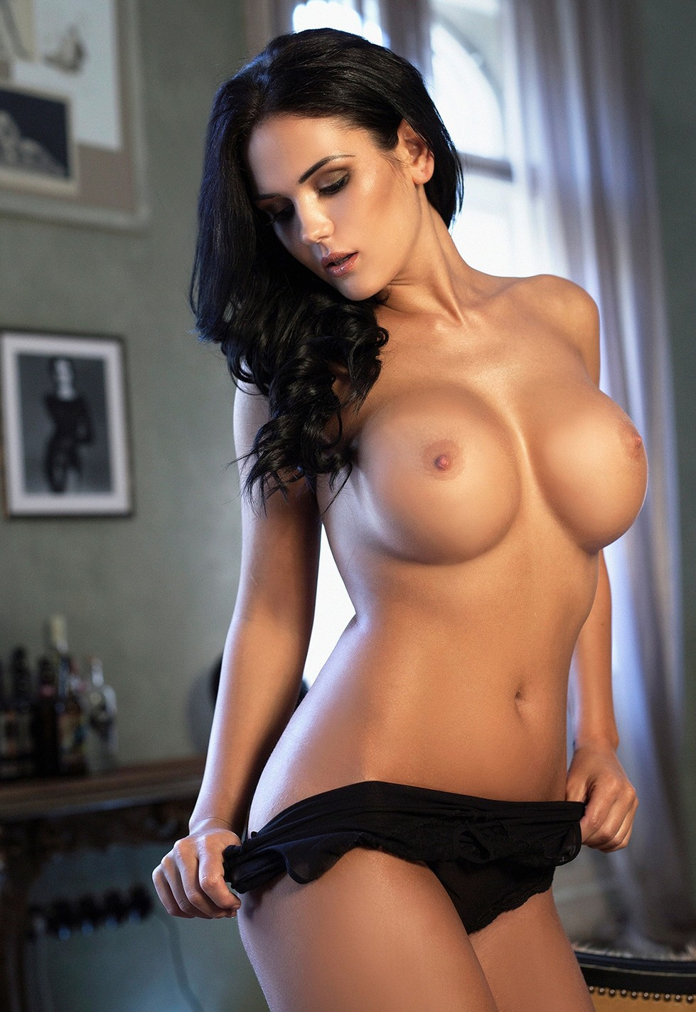 Black haired Dina escort in Budapest